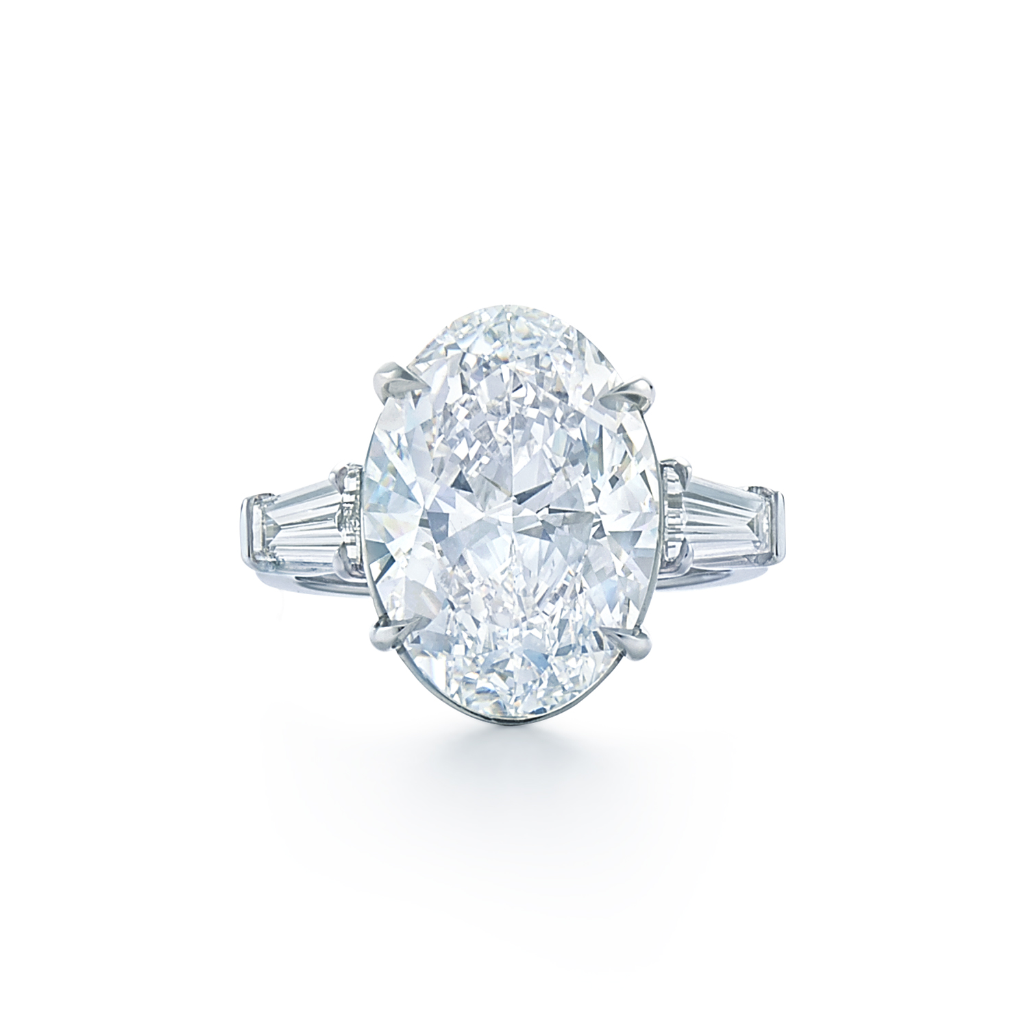 oval diamond ring with tapered baguette side stones set