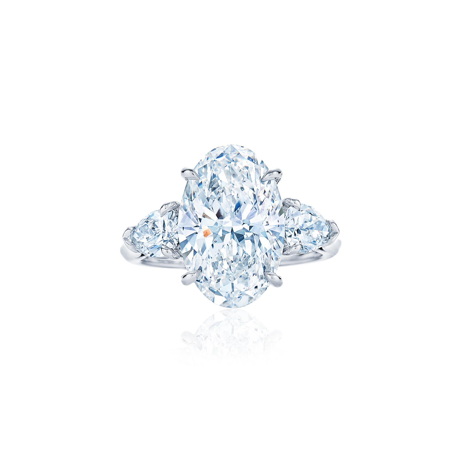 oval diamond ring with pear side stones set in platinum