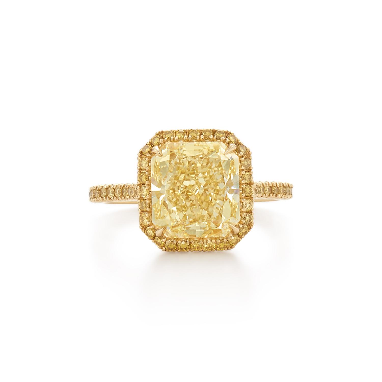 Radiant yellow diamond ring in pave diamond halo. Set in 18k ...