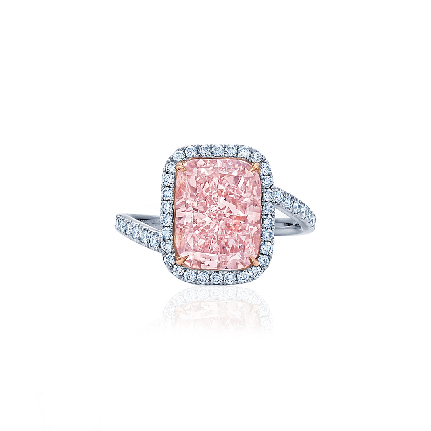 radiant fancy pink diamond ring with diamond halo and band